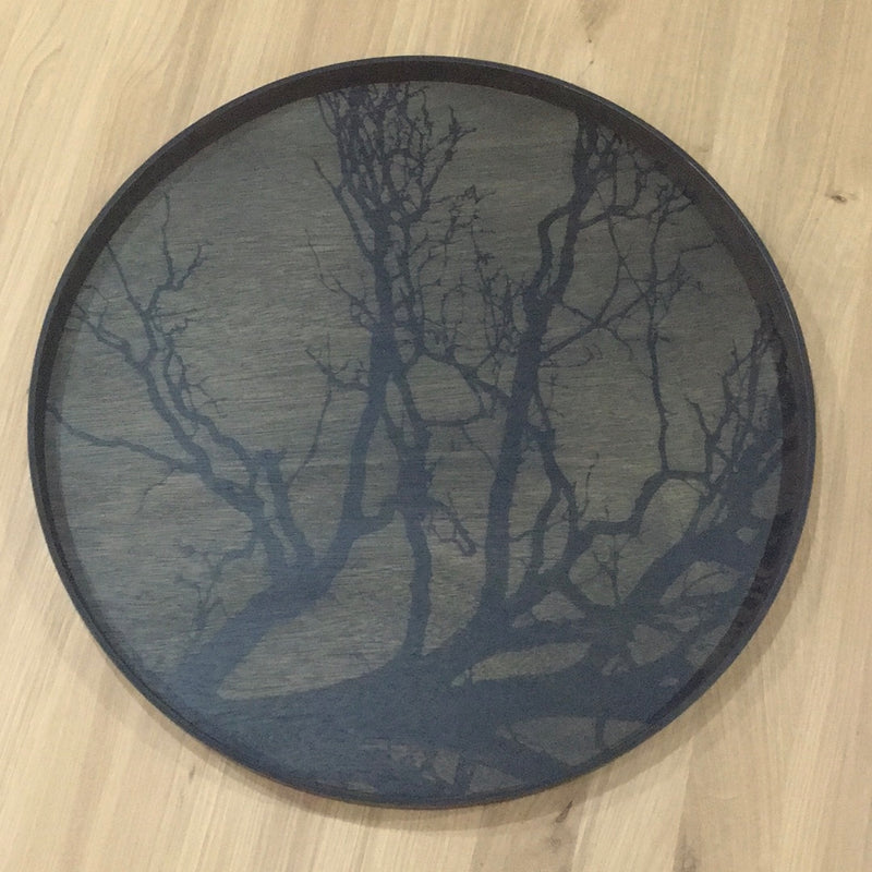 wood tray, with black tree on dark background, printed onto bottom of tray. black base