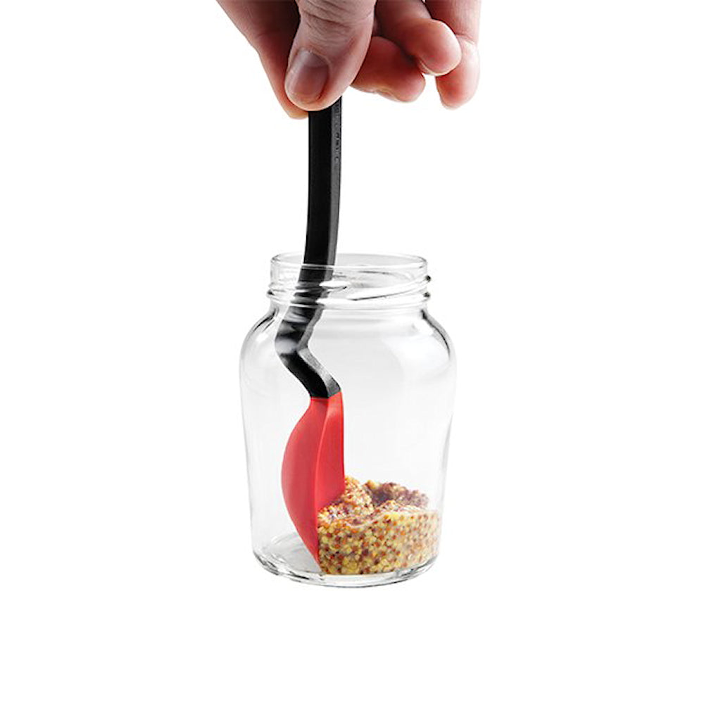 silicone red spoon end scraping contents out of jar. black handle
