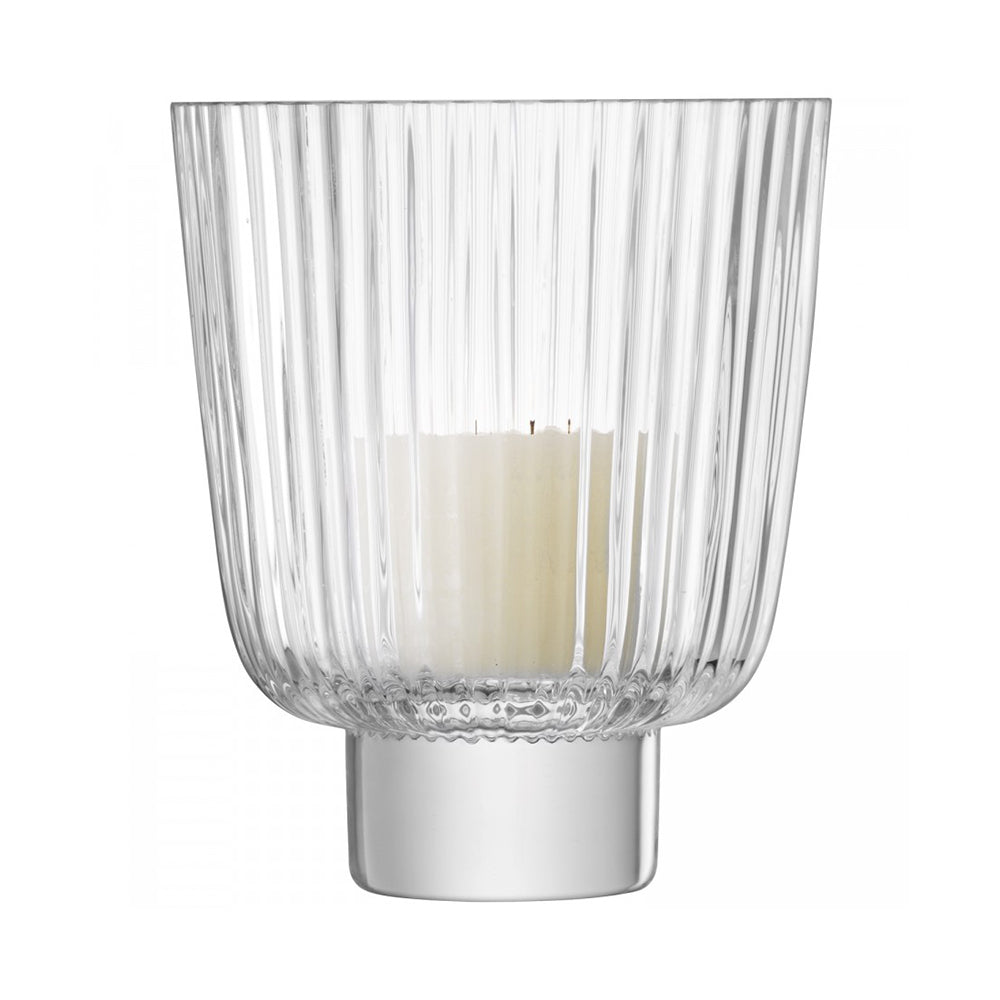clear ribbed glass candle holder, on heavy thick glass base.