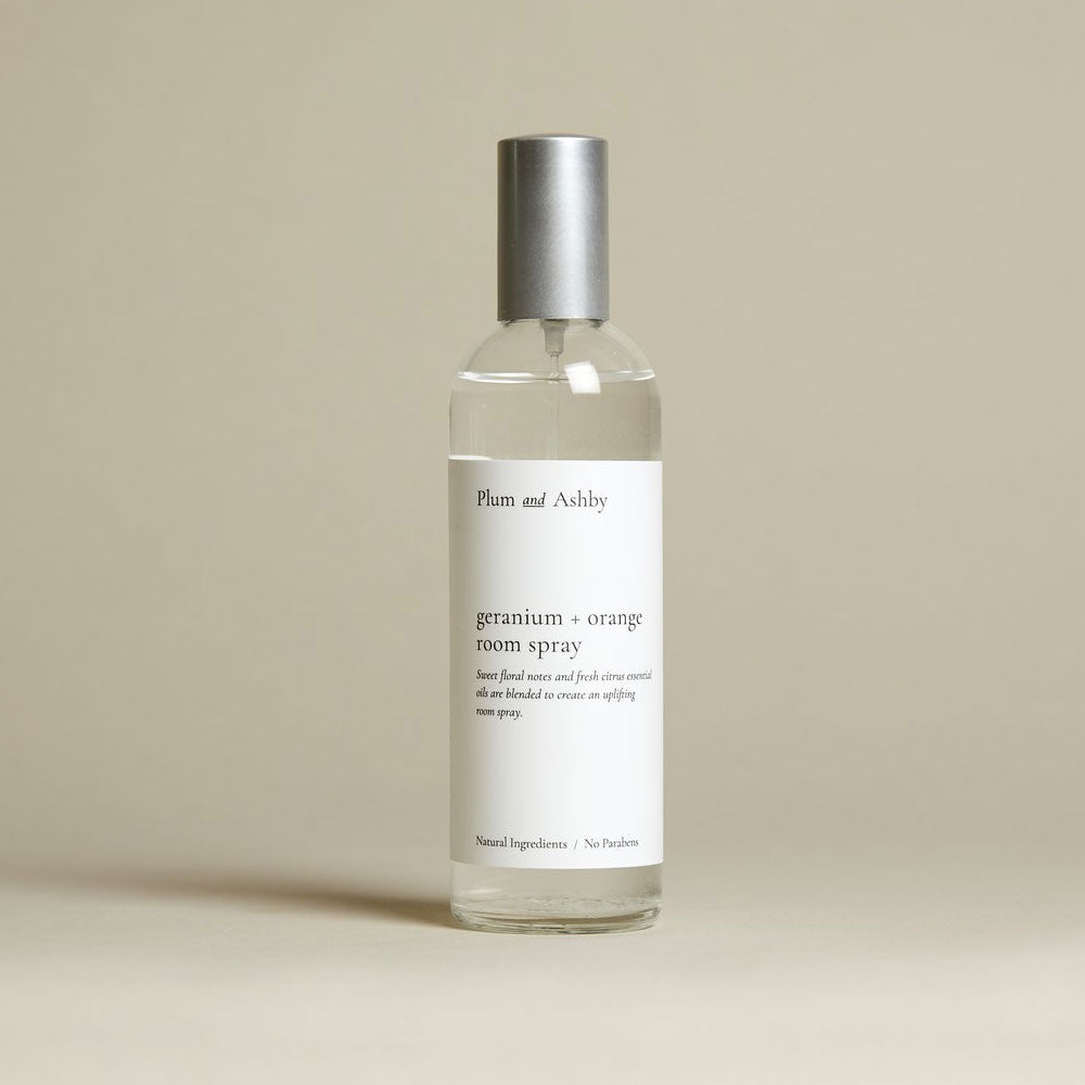 clear glass bottle of clear room spray- white label.
