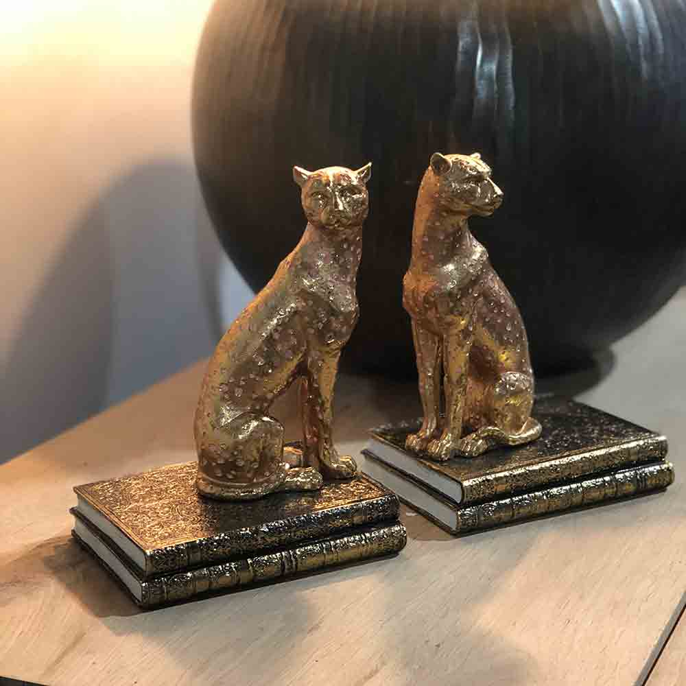 cheetah bookends pair. gold colour with pink spots