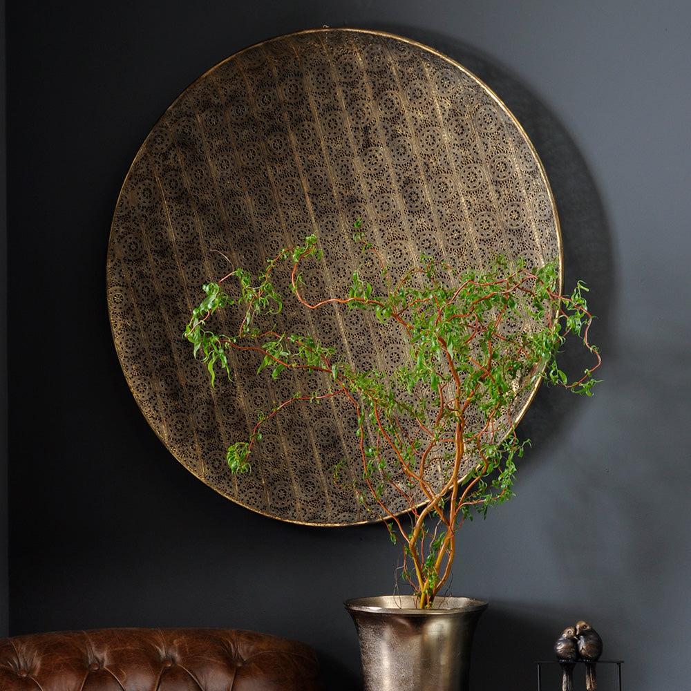 round filigree metal wall hanging, a large disc for wall decor.