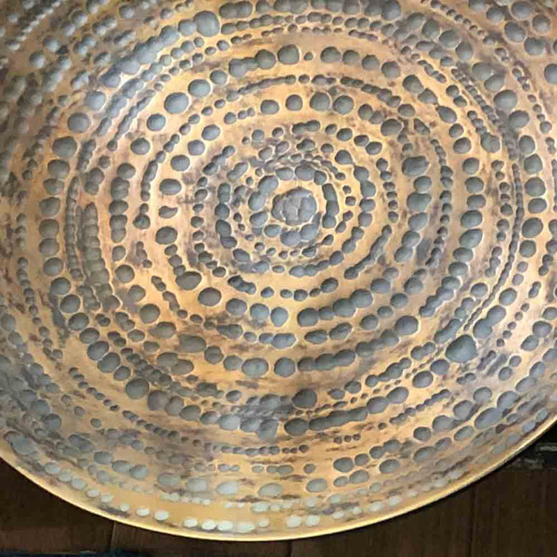 wall plate, dished golden plate, with textured dimpled patterning.
