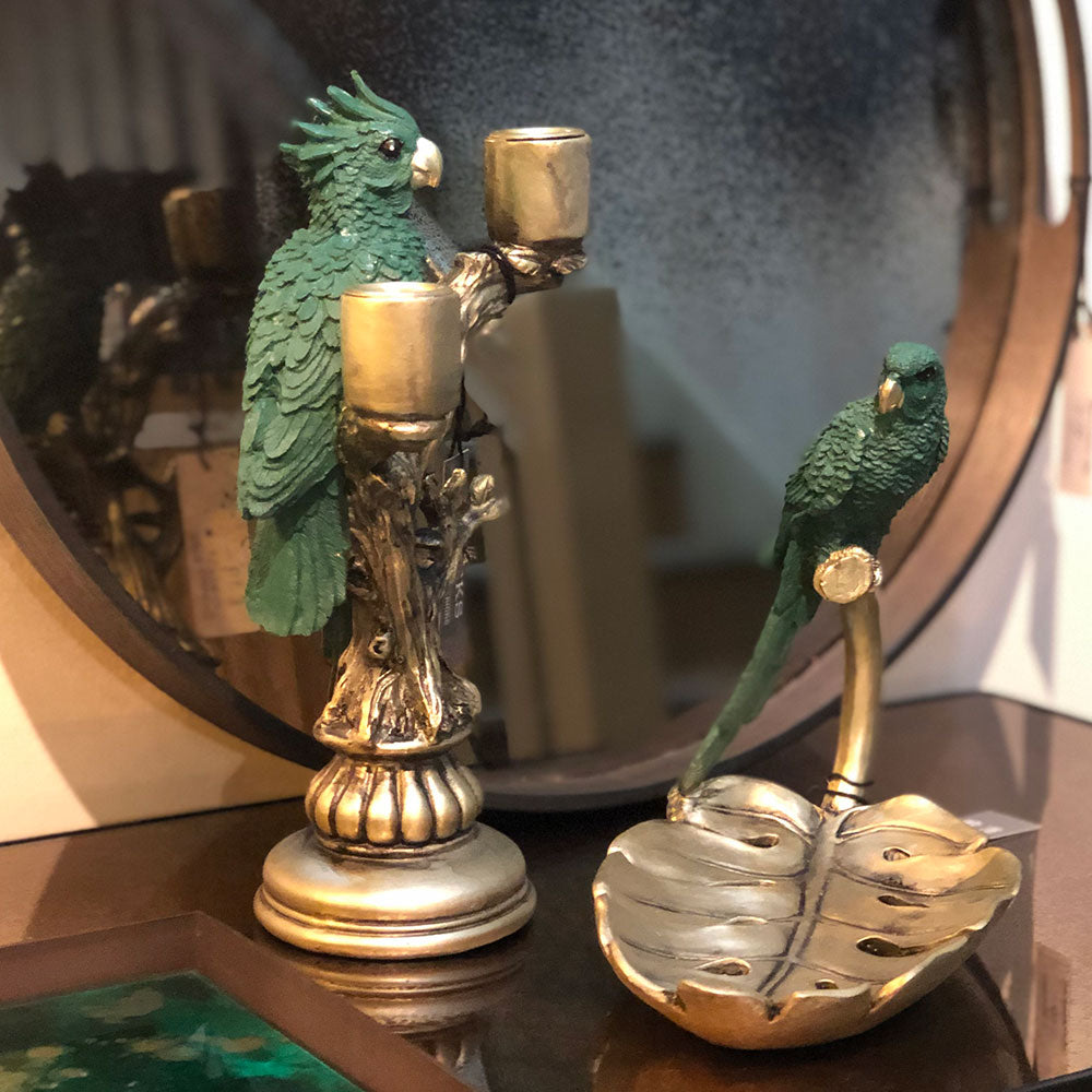 green parrot and cockatoo accessories on golden bases.