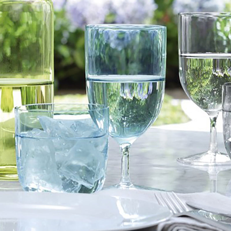 Hint collection water and wine glasses in Aqua colour, set on an outdoor dining table