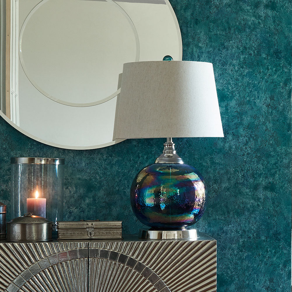 Ball shaped Mercury glass base table lamp with linen coloured shade. shown on sideboard