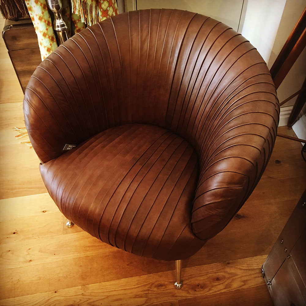 pleated leather jensen chair,top view. pleasting is all over front and back. silver legs.
