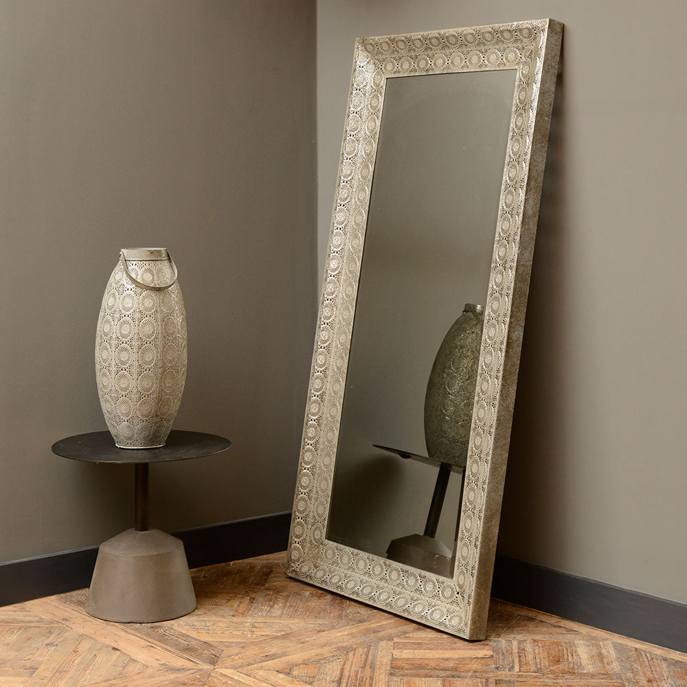 maura mirror standing on the floor in the portrait position. shown in hallway.