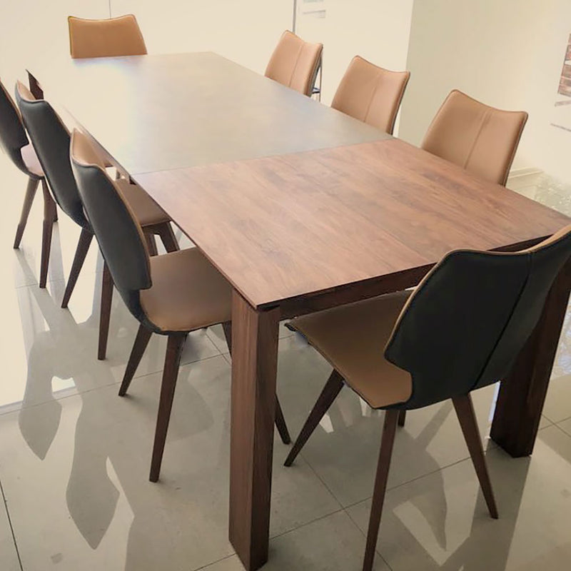 oxford-1 table with cermaic top. table and extension in dark walnut wood. shown with C1 dining chairs