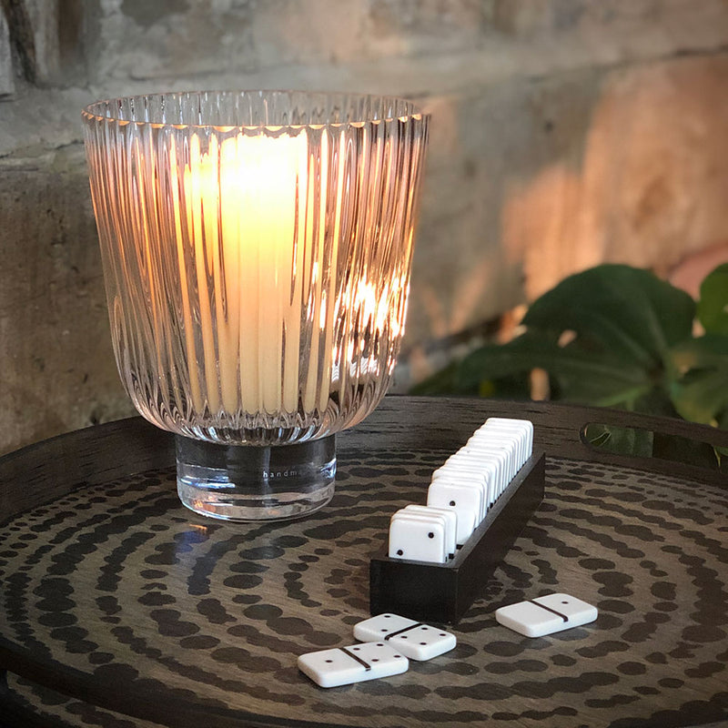 pleated-glass-hurricane-lit-candle-with-dominoes