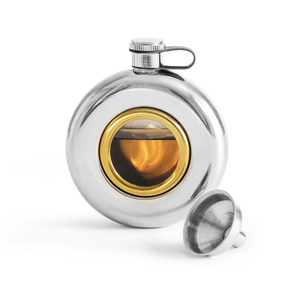 silver coloured metal round hip flask with glass window. screw cap lid. shown with funnel.