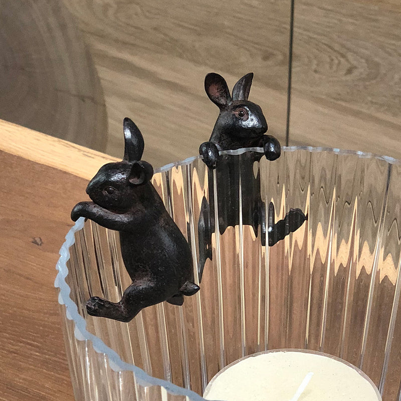 decorative dark finish hanging hare, holds onto a pot or hurricane.