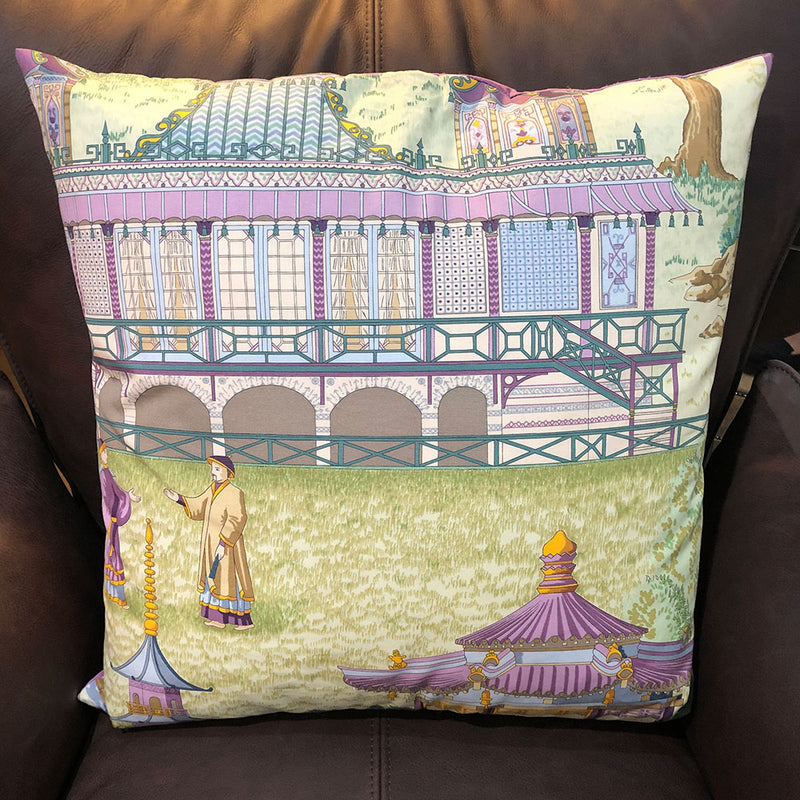 cushion with all over image of a pagoda scene, purples and greens