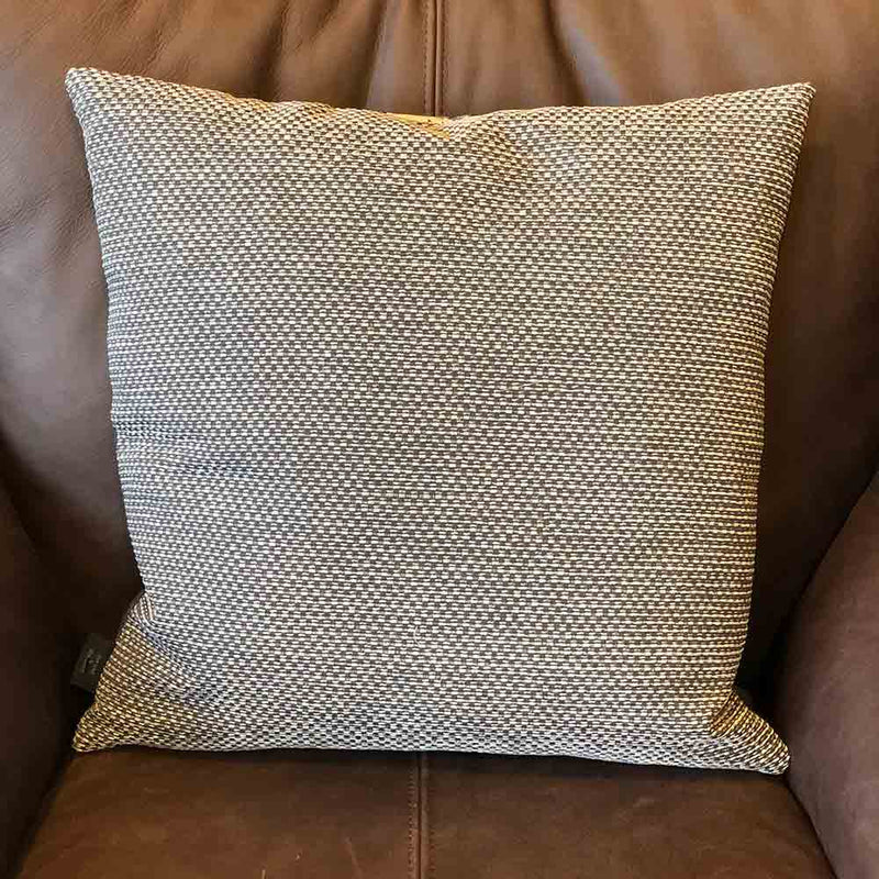 cushion back with textured grey fabric.