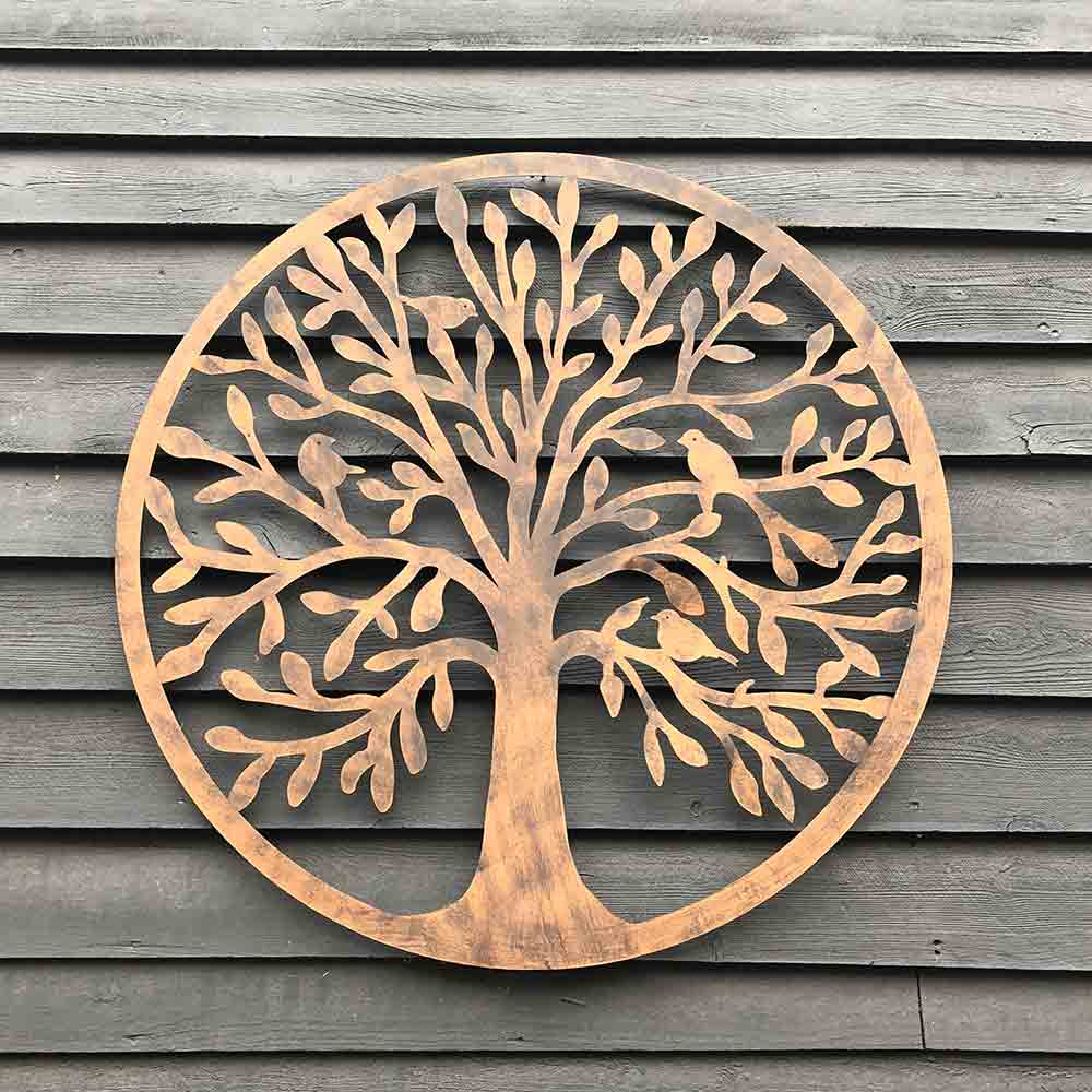 metal round wall plaque, shows birds sitting in the branches of the tree