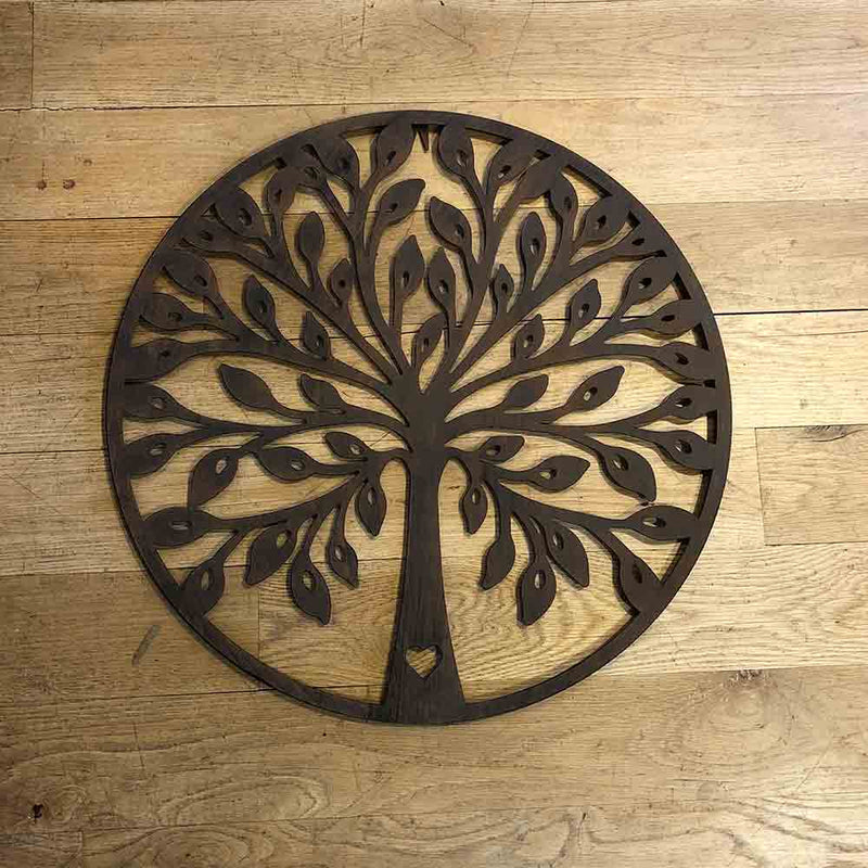 dark brown metal wall art, circle with tree of life design.