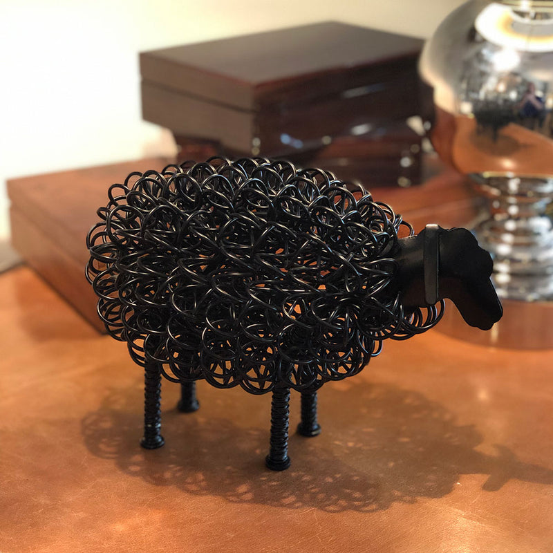 close up image of black wired Sheep displayed on table