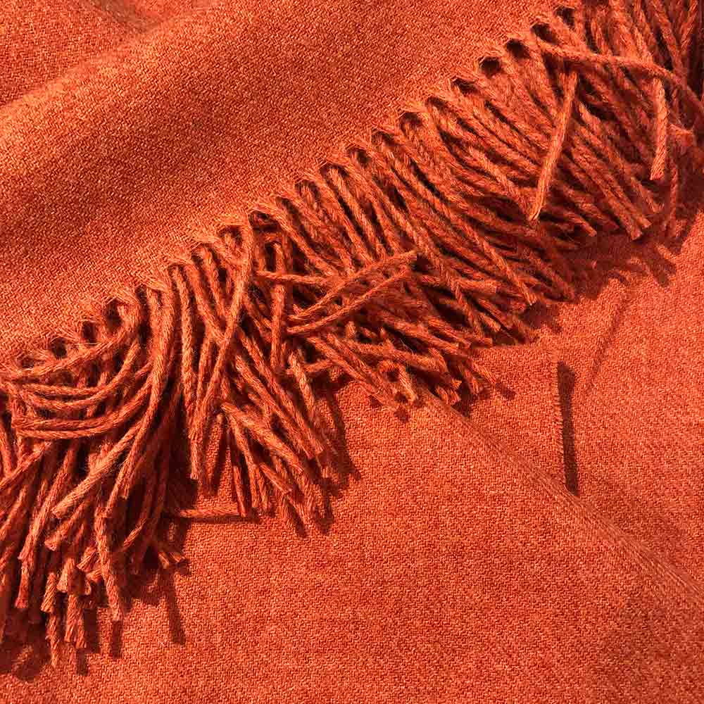 orange plain colour wool throw with fringe tassels