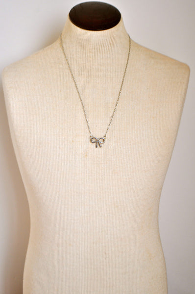 A Silver Lining Bow Necklace