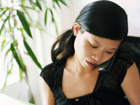 Cradling Your Phone - Your Back Pain Relief