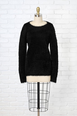 black fuzzy open back sweater