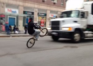 crazy wheelie in front of a truck