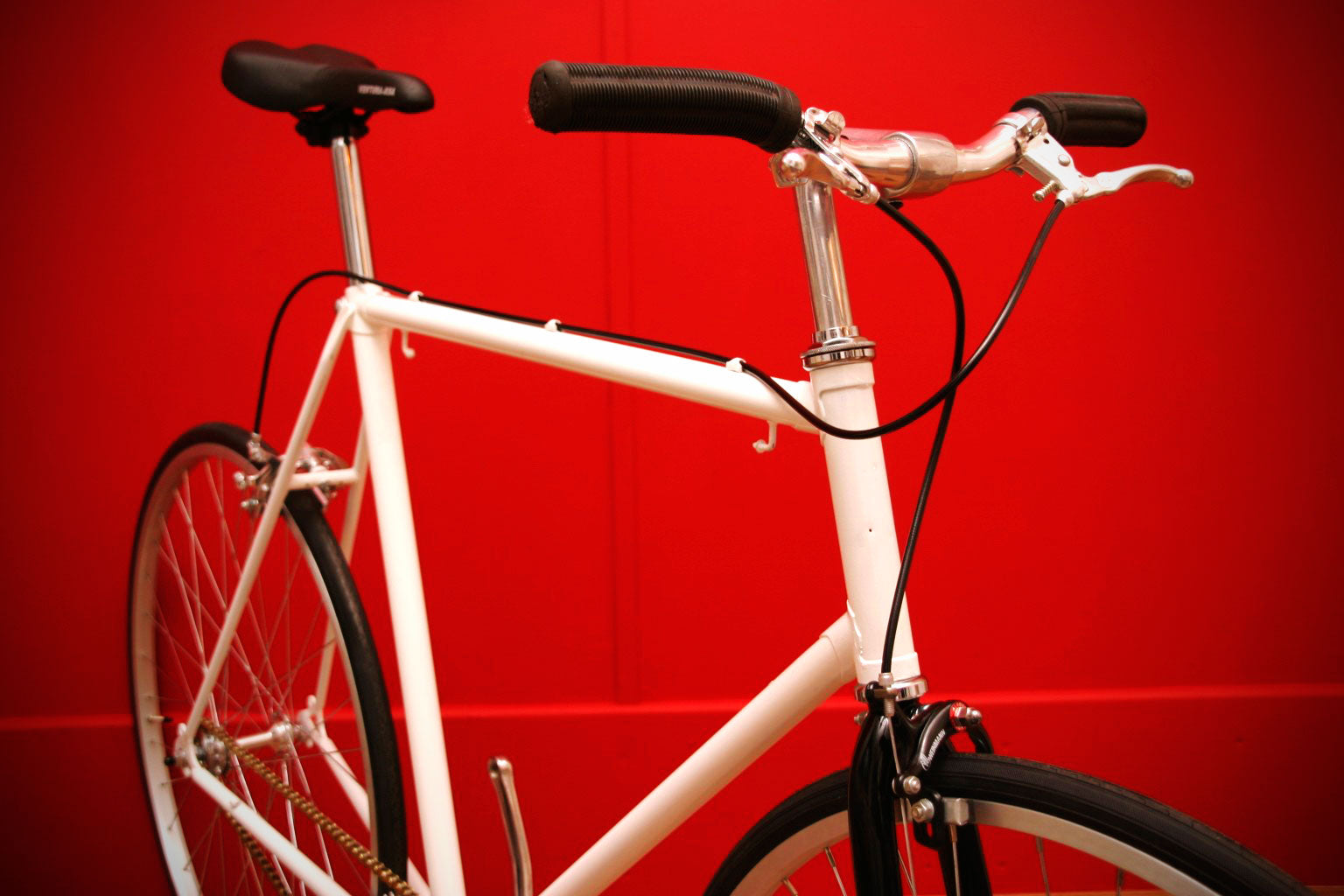 white raleigh single speed bike