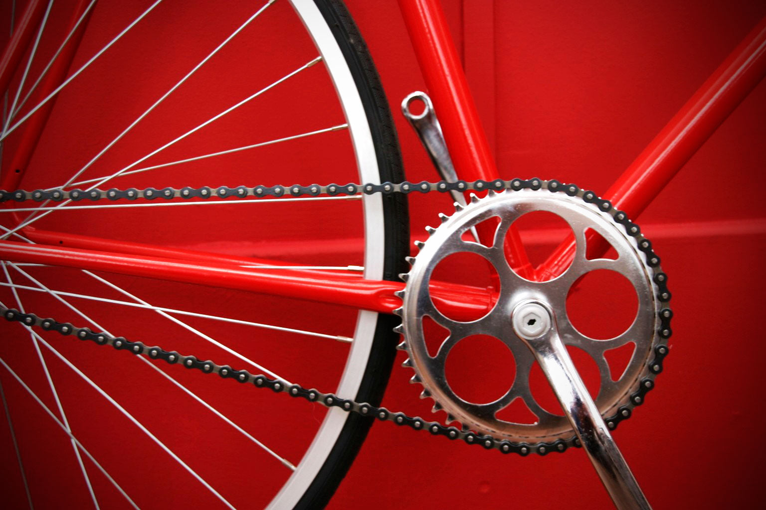 silver crank on red bike