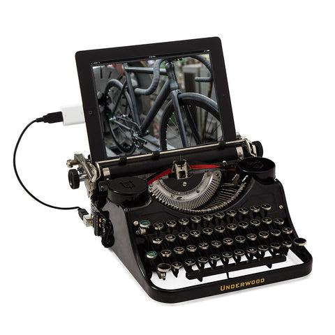 writing about fixed gear bikes on typewriter
