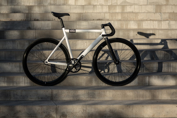 white premium bike by State Bicycle Co.