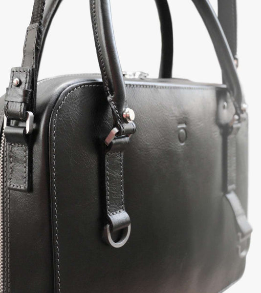 Women's leather handbag attached on bicycle