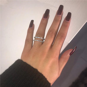 woman wears a double band ring in silver