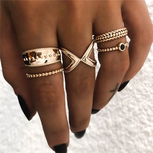 six vintage gold rings on woman's hand