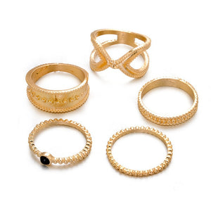 six gold vintage gold rings with white background
