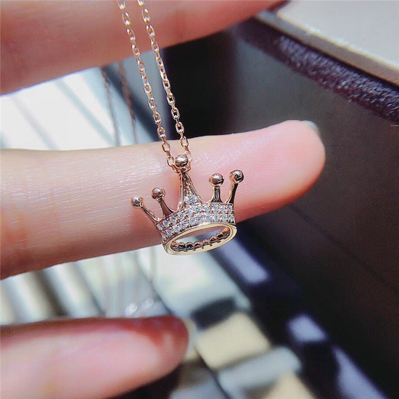 18k rose gold crown necklace with Sl1 diamonds