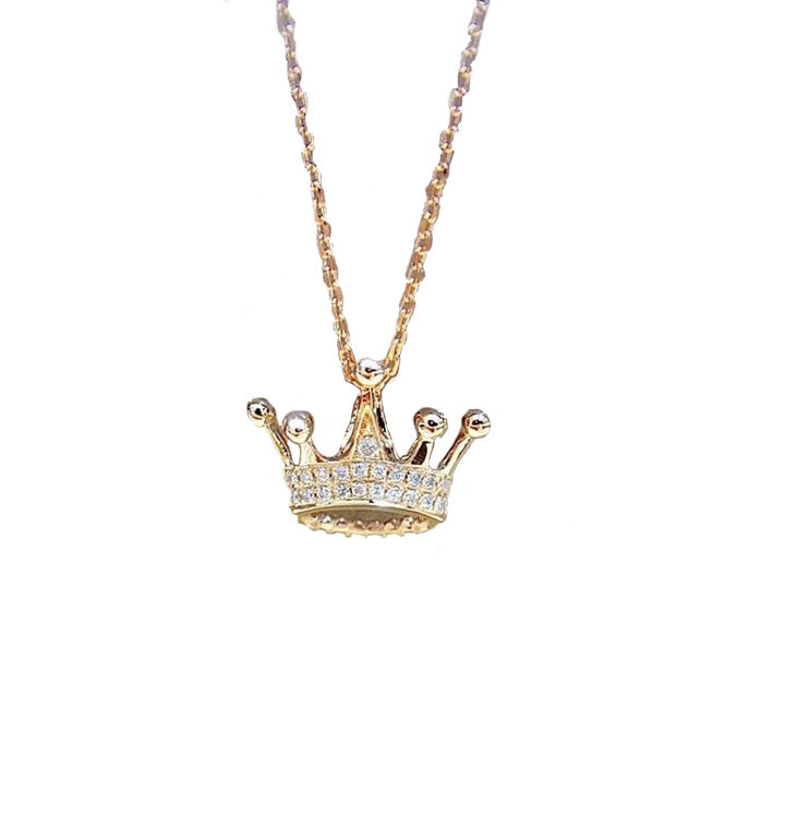 a diamond crown pendant hanging from a 18k rose gold chain