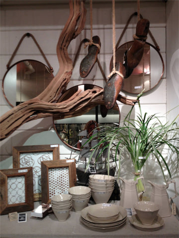 Fun display at Market using natural wood and greenery
