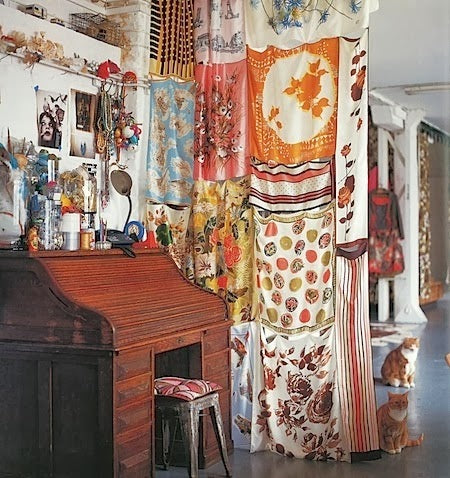 A room divider created from vintage scarves.