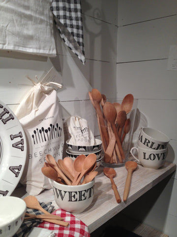 Sir/Madam wooden cooking utensils displayed with other home goods