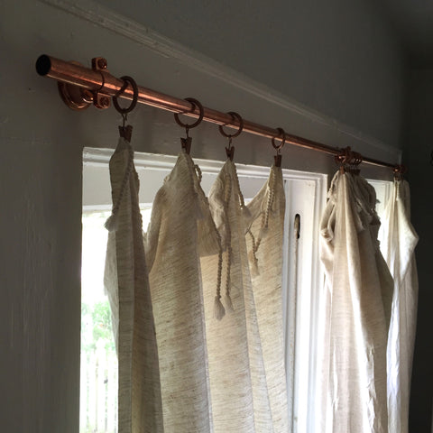DIY copper plumber's pipe curtain rods project.