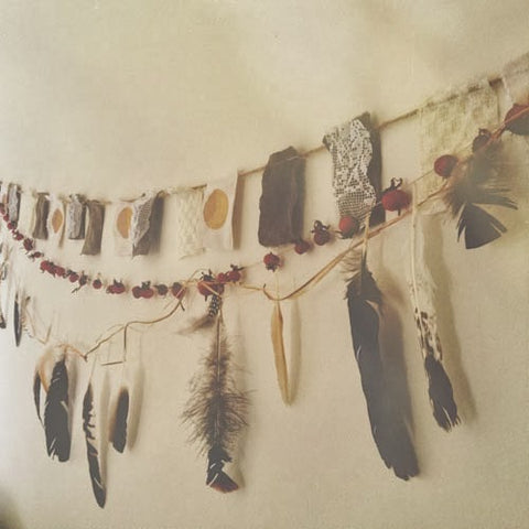 Boho feathers as a wall garland.