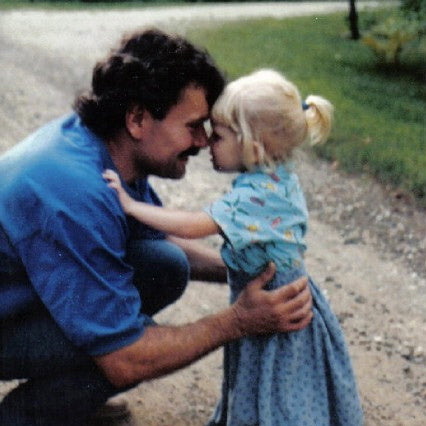 Morgan as a child in dress up cloth's with her dad.