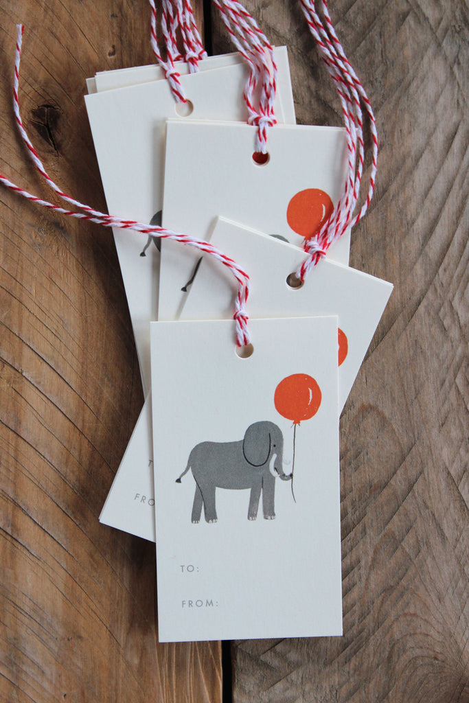 Set of gift tags with grey elephant and ballon for easy tagging of children's gifts.