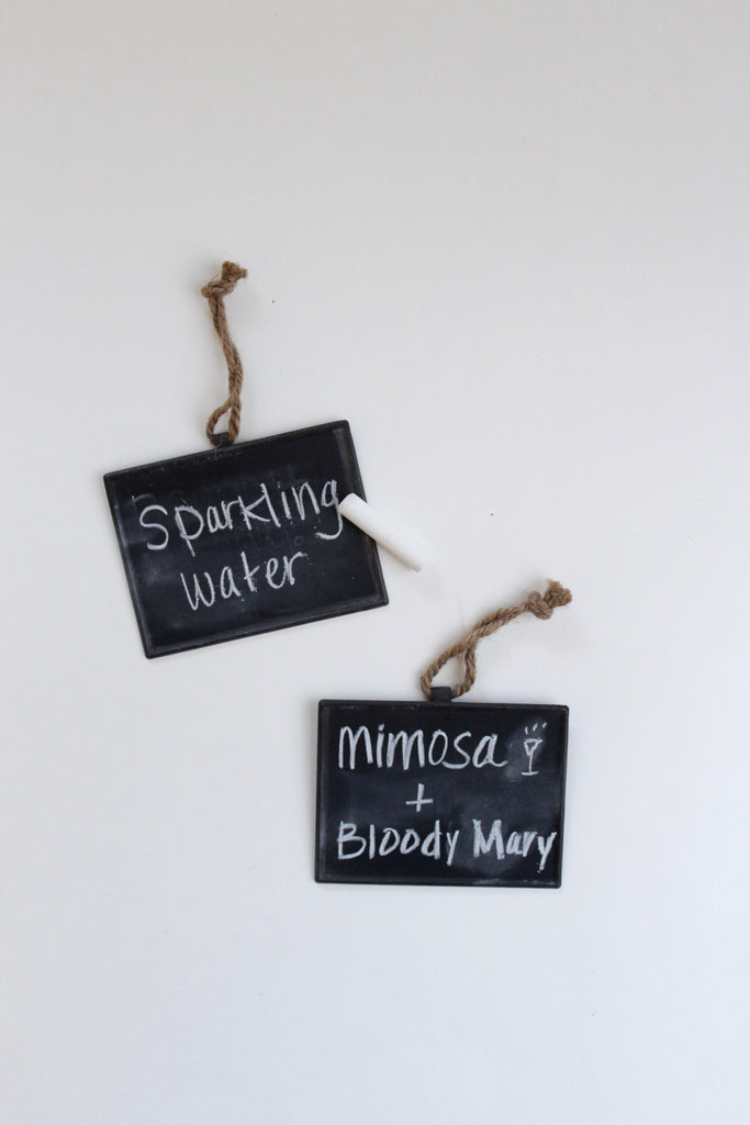 Chalkboard hang tags for labeling bottled beverages.