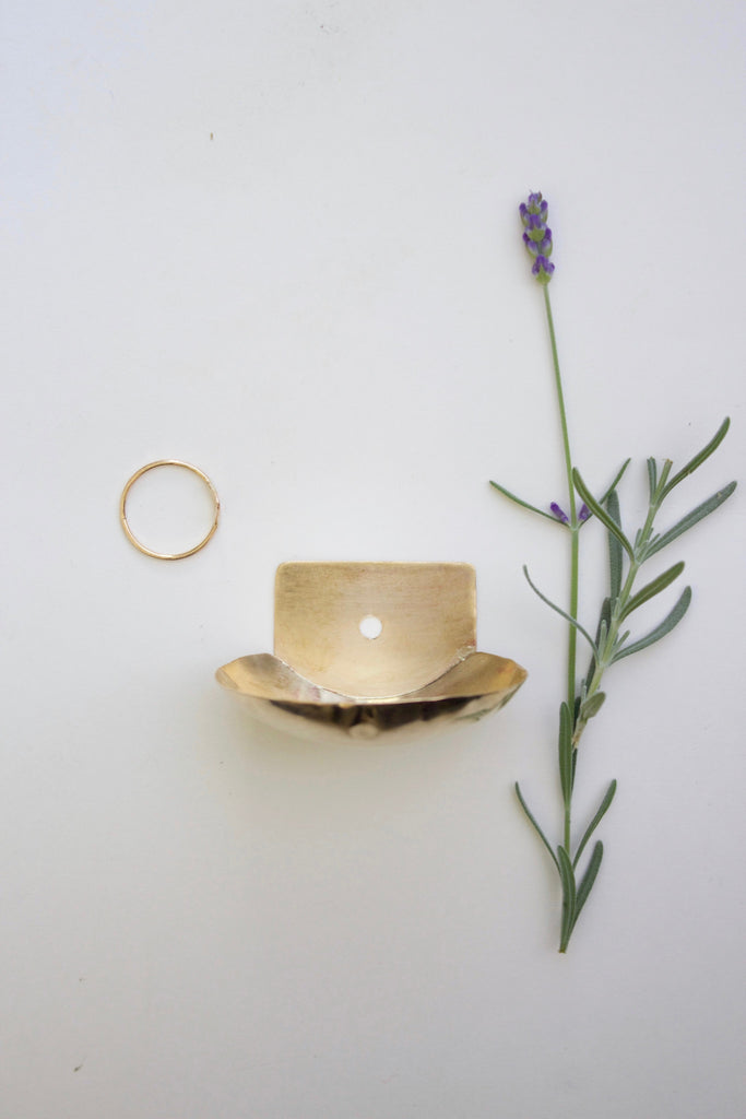 Handmade small brass wall dish for collecting rings and jewelry.