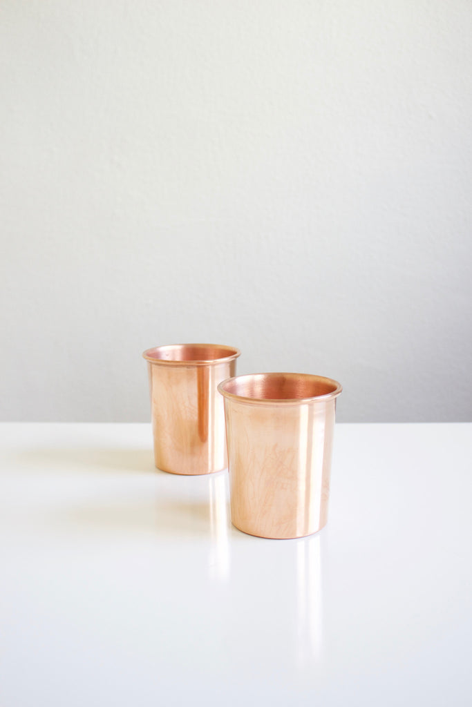 Handmade stackable copper cups.