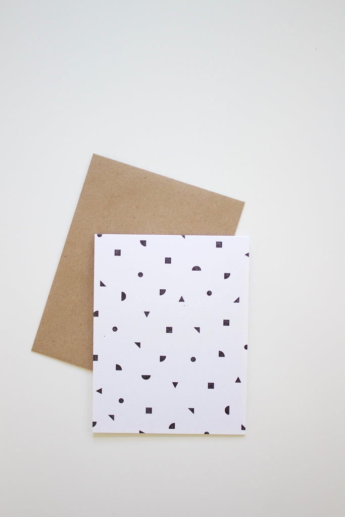Handmade geometric confetti greeting card in black and white.