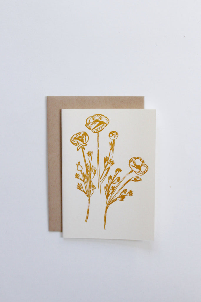 Hand illustrated and letterpress printed golden flowers blank greeting card.