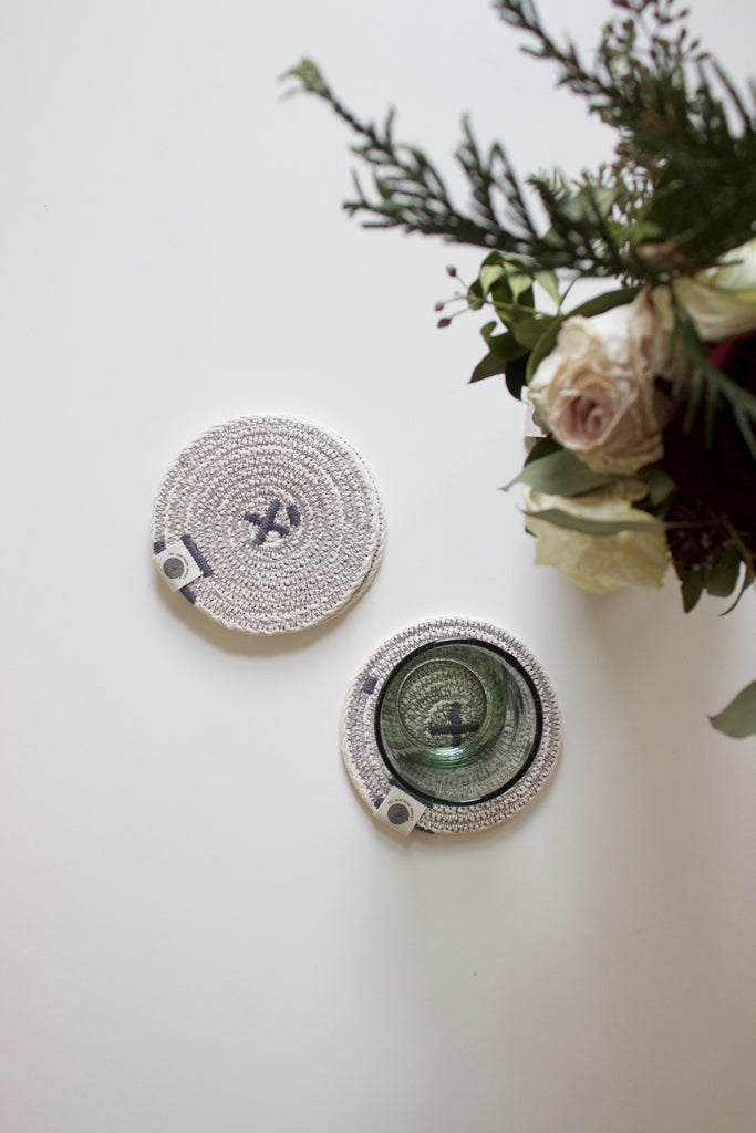 Hand woven fabric coasters in grey.