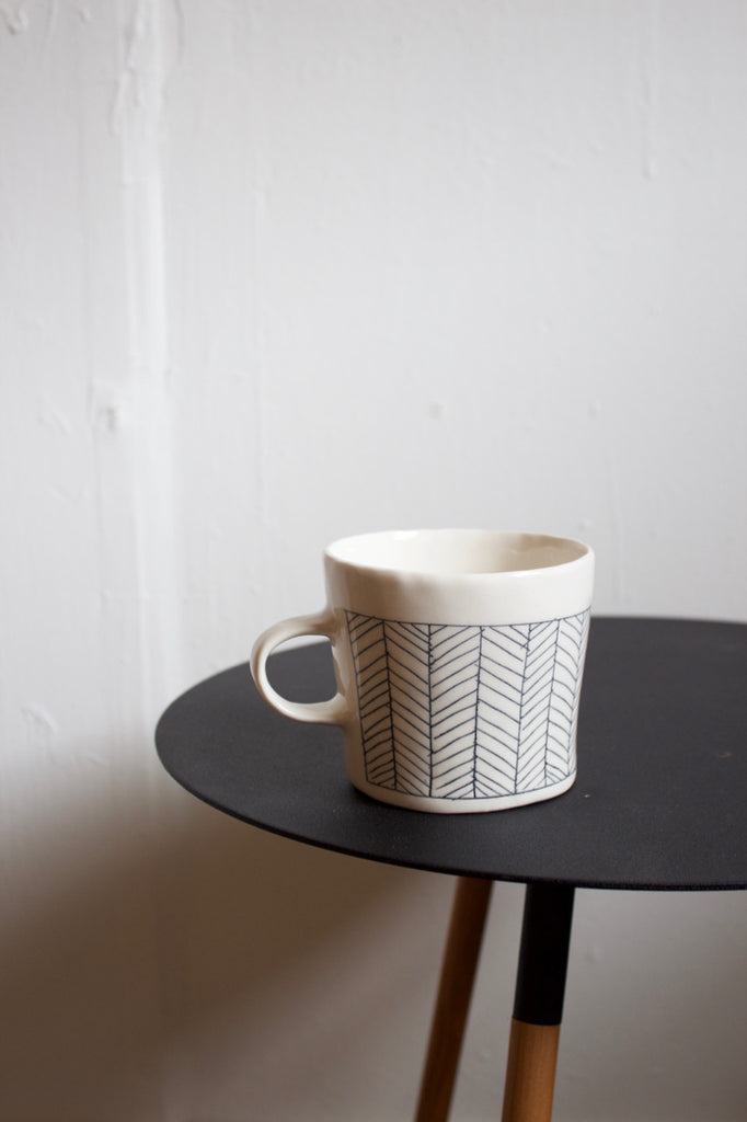White pottery coffee mug handmade by Elizabeth Benotti in the USA.